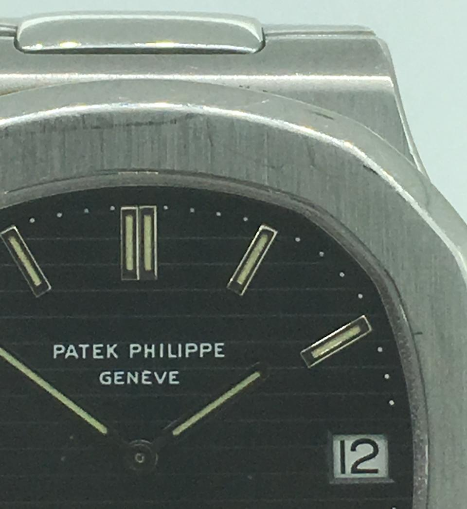 Patek Philippe. A fine and rare stainless steel automatic calendar bracelet watch with original Asprey receipt  Jumbo Nautilus Retailed by Asprey, Ref: 3700/1, Sold 1st August 1983