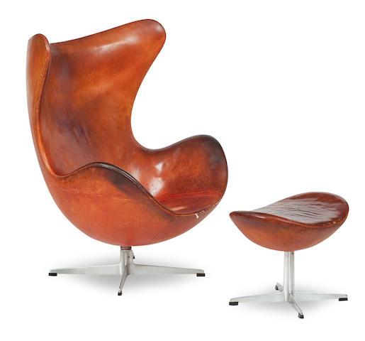 Arne Jacobsen (Danish, 1902-1971) An Egg chair and stool, designed 1958, manufactured by Fritz Hansen