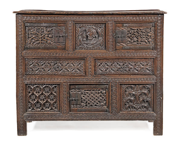 An impressive Henry VIII joined oak and walnut livery cupboard, circa 1530, with restorations