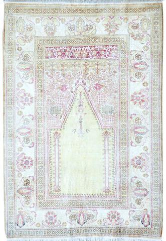 A Persian silk rug 121 x 179cm