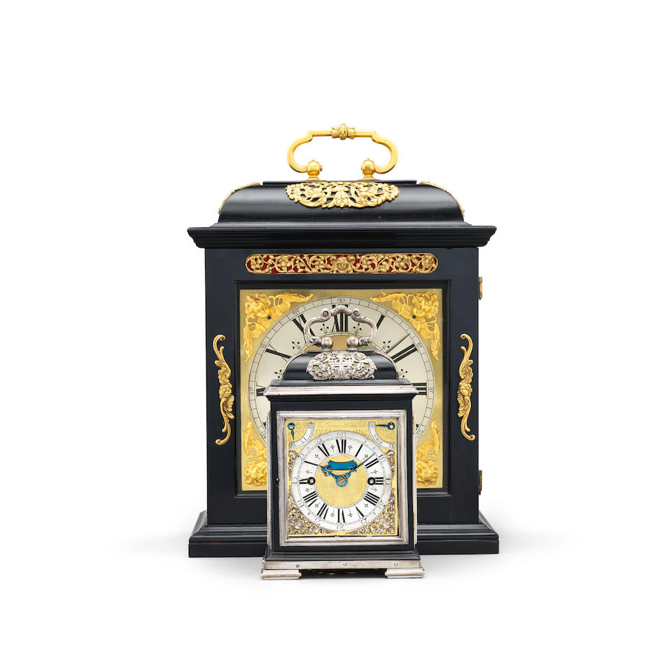 A HIGHLY IMPORTANT LATE 17TH CENTURY SILVER-MOUNTED EBONY STRIKING AND QUARTER REPEATING MINIATURE TABLE CLOCK, WITH ROYAL PROVENANCE, KNOWN AS THE 'Q' CLOCK, THE SMALLEST EBONY CASED CLOCK BY THOMAS TOMPION IN THE WORLD Thomas Tompion, London, number 222.