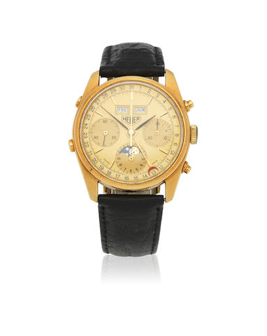 Heuer. An 18K gold manual wind triple calendar chronograph wristwatch with moon phase  Golden Hours, Ref: 721.208, Circa 1985