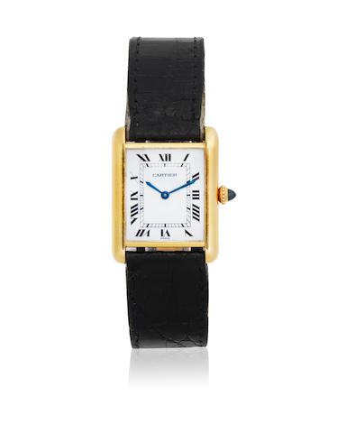 Cartier. A lady's 18K gold manual wind rectangular wristwatch  Tank, Circa 1990