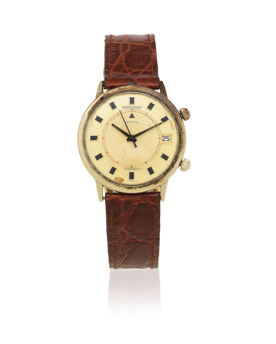 Jaeger-LeCoultre. A gold plated automatic calendar alarm wristwatch  Memovox, Circa 1955