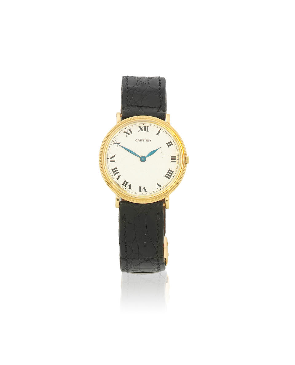 Cartier. A mid-size 18K gold manual wind wristwatch Circa 1950