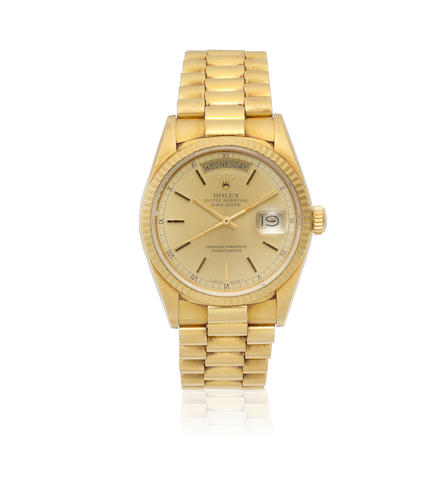 Rolex. An 18K gold automatic calendar bracelet watch  Day-Date, Ref: 18028, Sold 23rd September 1987