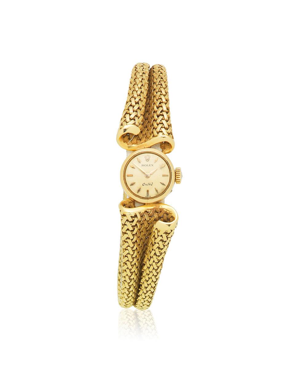 Rolex. A lady's 18K gold manual wind bracelet watch with unusual bracelet  Orchid, Ref: 9524, London Import mark for 1970