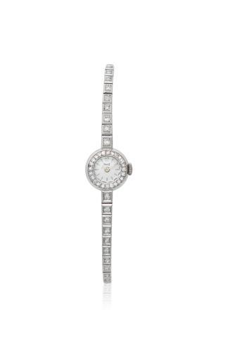 Piaget. A lady's 18K white gold and diamond set manual wind bracelet watch Circa 1980