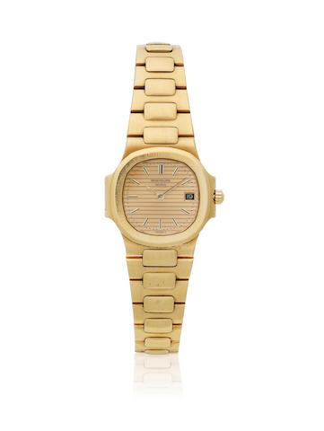 Patek Philippe. A lady's 18K gold quartz calendar bracelet watch  Nautilus, Ref: 4700/001, Sold 27th July 1984