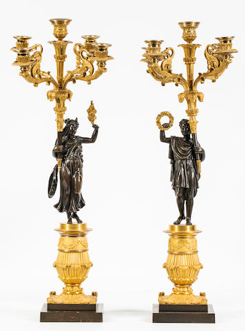 A pair of Restoration patinated and gilt-bronze candelabras (2)