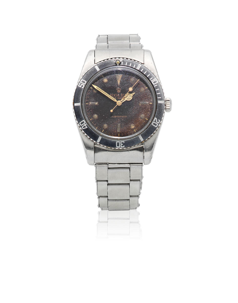 Rolex. A stainless steel automatic bracelet watch with tropical gilt dial  Submariner, Ref: 6536-1, Circa 1958