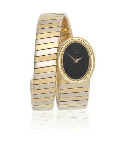 Chopard. A lady's 18K white and yellow gold manual wind 'serpent form' bracelet watch Circa 2000