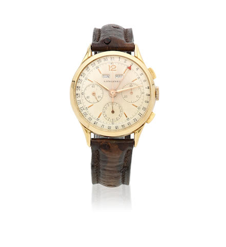 Longines. An 18K gold manual wind triple calendar chronograph wristwatch Ref: 3902, Circa 1950