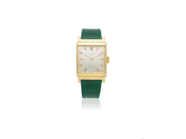 Patek Philippe. An 18K gold manual wind curved rectangular wristwatch Ref: 2517, Circa 1950