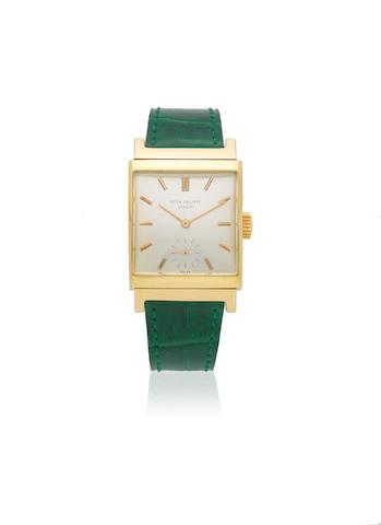 Patek Philippe. An 18K gold manual wind curved rectangular wristwatch Ref: 2517, Circa 1950