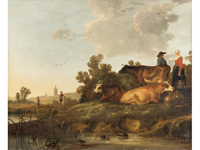 Circle of Aelbert Cuyp (Dordrecht 1620-1691) A drover and milkmaid standing beside cattle, a view to a town in the distance