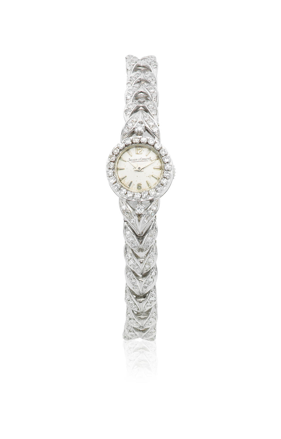 Jaeger-LeCoultre. A lady's 18K white gold and diamond set cocktail bracelet watch Circa 1959