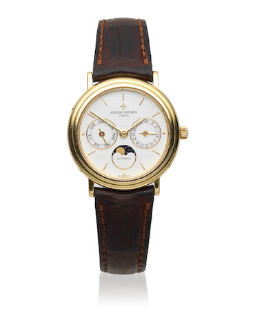 Vacheron Constantin. An 18K gold automatic annual calendar wristwatch with moon phase Ref: 46009 73009, Circa 1990