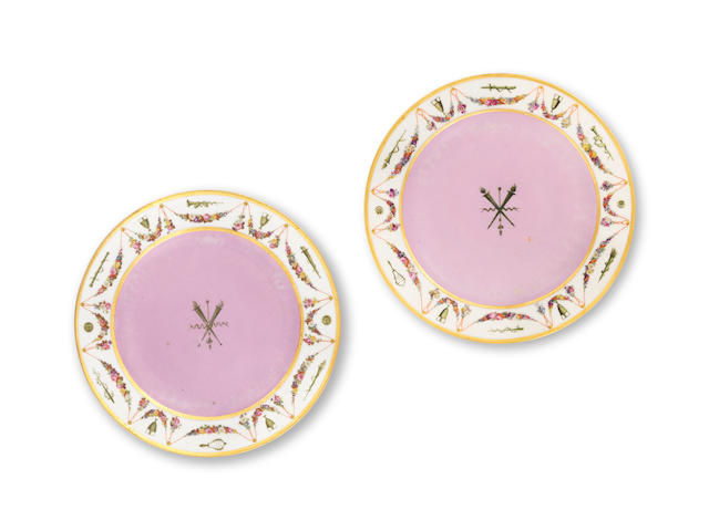 A pair of Sèvres dinner plates from the 'Service fond rose guirlande de fleurs et attributs' made for Napoleon I, circa 1805