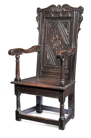 A Charles I joined oak panel-back open armchair, West Country,  circa 1640