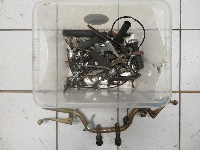 An assortment of control levers and associated parts