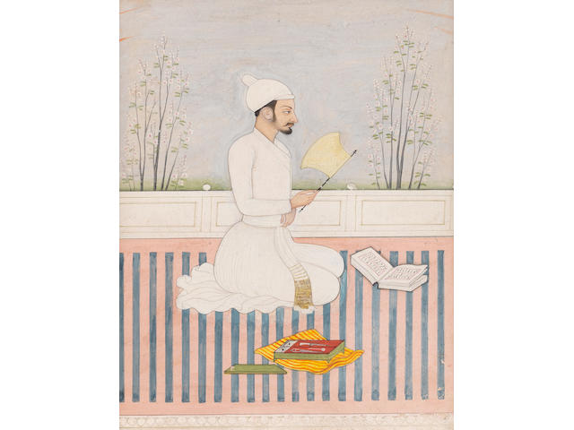 A court secretary, wearing a white jama, seated on a terrace, writing instruments and a manuscript before him Jammu, by an artist of the second generation after Nainsukh, early 19th Century