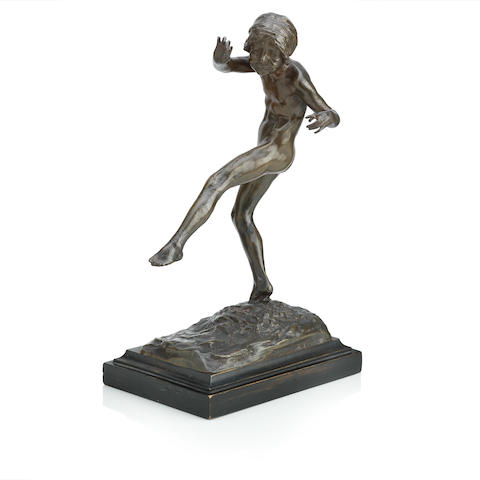 An early 20th century bronze figure of a child