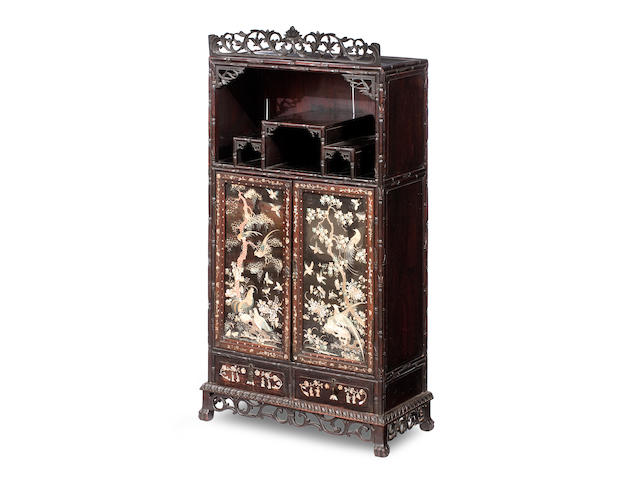 A blackwood 'faux-bamboo'-framed cabinet with embroidered silk panel doors Qing Dynasty, late 19th century