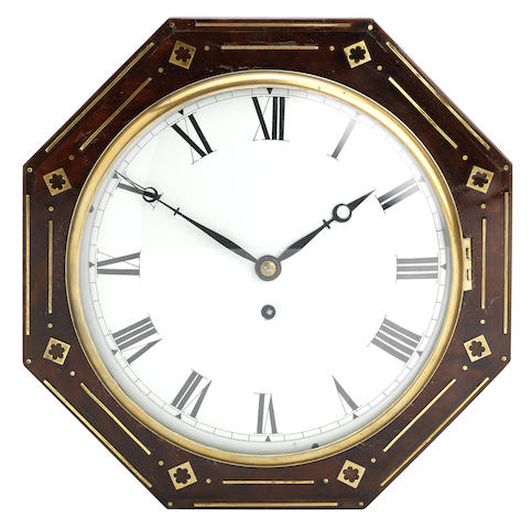 A 19th century stained mahogany and brass inlaid octagonal framed wall timepiece