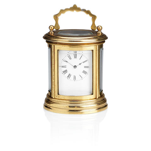 An early 20th century brass oval carriage clock