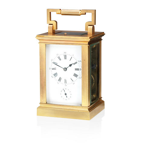A 20th century gilt brass repeating alarm carriage clock