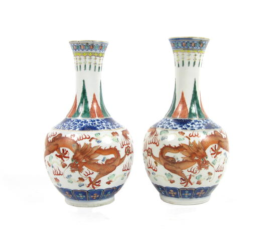 A pair of underglaze blue and enamelled bottle vases Kangxi four-character mark but late 19th century (2)