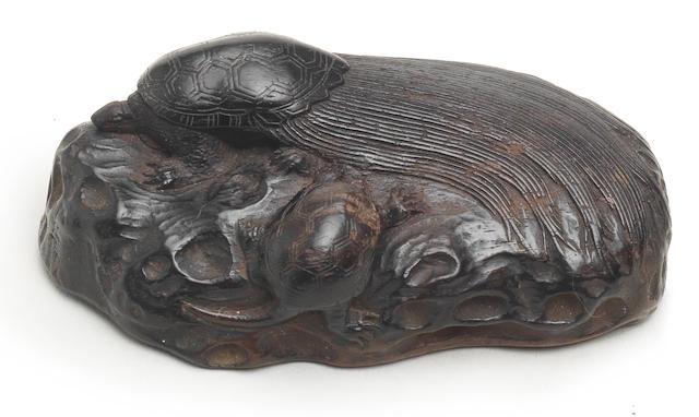 A kurogaki (black persimmon) wood netsuke of a minogame and terrapin  Style of Seiyodo Tomiharu, Iwami Province, late 18th century