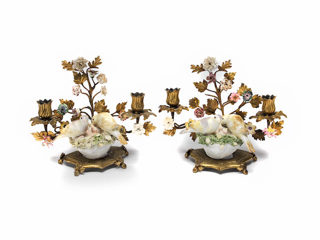 A pair of gilt metal and porcelain candelabra with Meissen models of birds Mid 18th Century