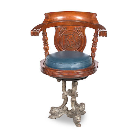 An early 20th century mahogany and cast iron ships swivel chair