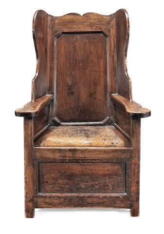 A George III joined pine and ash 'lambing' wing armchair, circa 1800