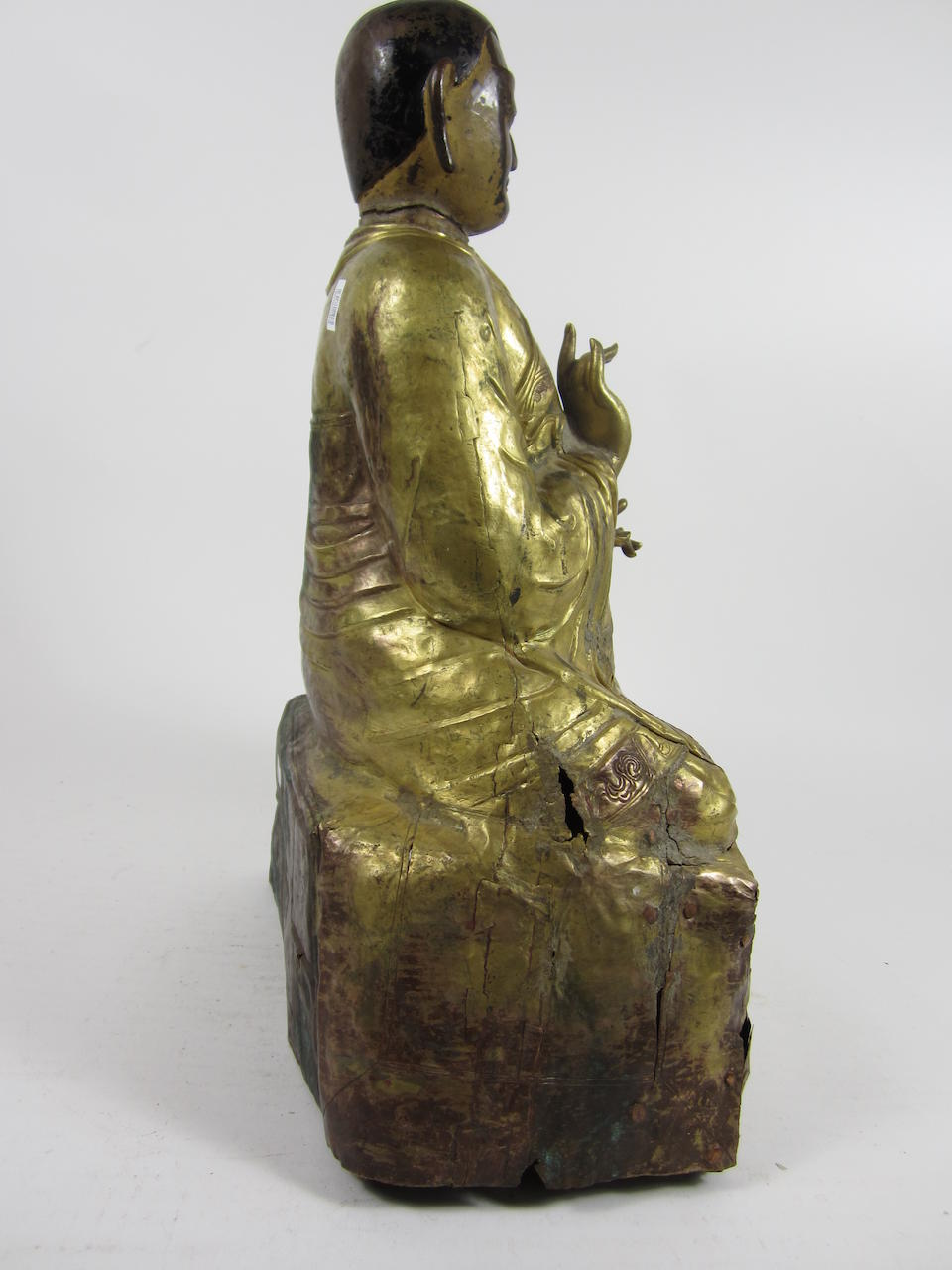 A Large repoussé gilt-bronze figure of a Lama Tibet, 18th century (3)
