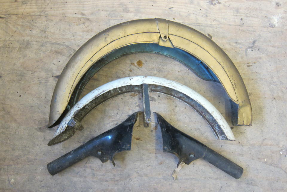 Two Triumph mudguards and a pair of Triumph nacelle legs