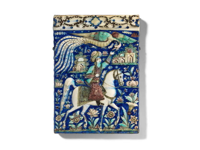 A Qajar moulded pottery tile depicting a youth on horseback feeding a simurgh swooping above him Persia, circa 1880