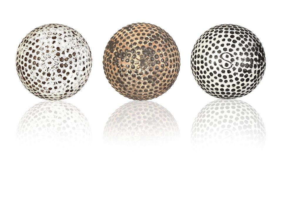 Three EARLY RUBBER CORED GOLF BALLS, CIRCA 1902