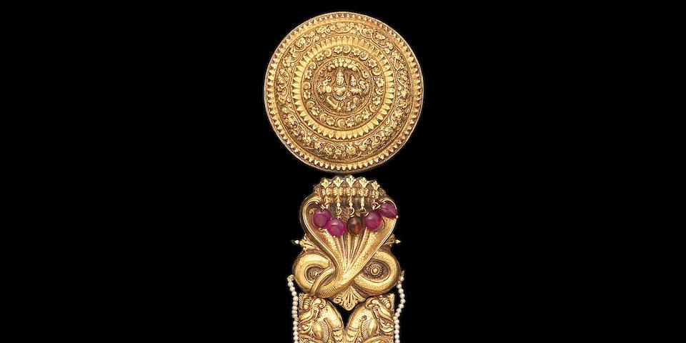 An impressive repoussé gold hair braid ornament (jadai nagam) Tamil Nadu, 19th Century