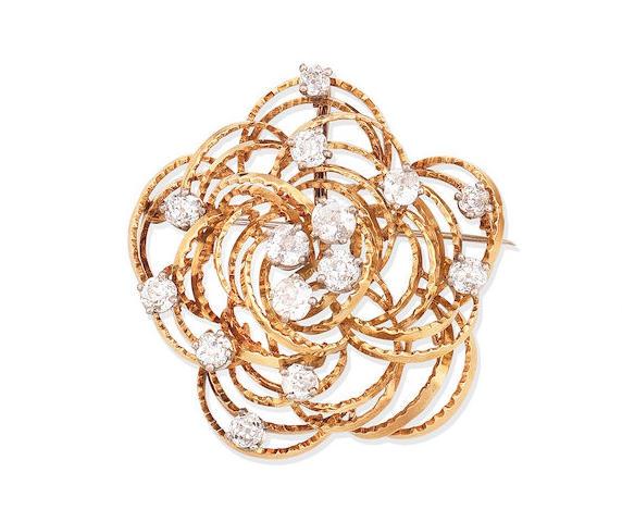 A diamond pendant/brooch,