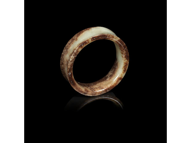 A yellow and russet jade bangle Shang Dynasty or later