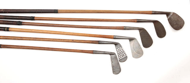 A SELECTION OF IRON GOLF CLUBS WITH UNUSUAL FACES