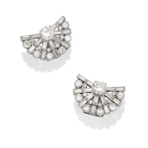 A pair of diamond earrings, by Cartier,