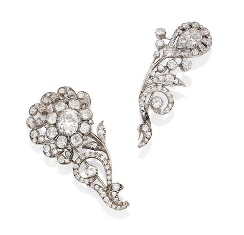 Two 19th century diamond scroll brooches