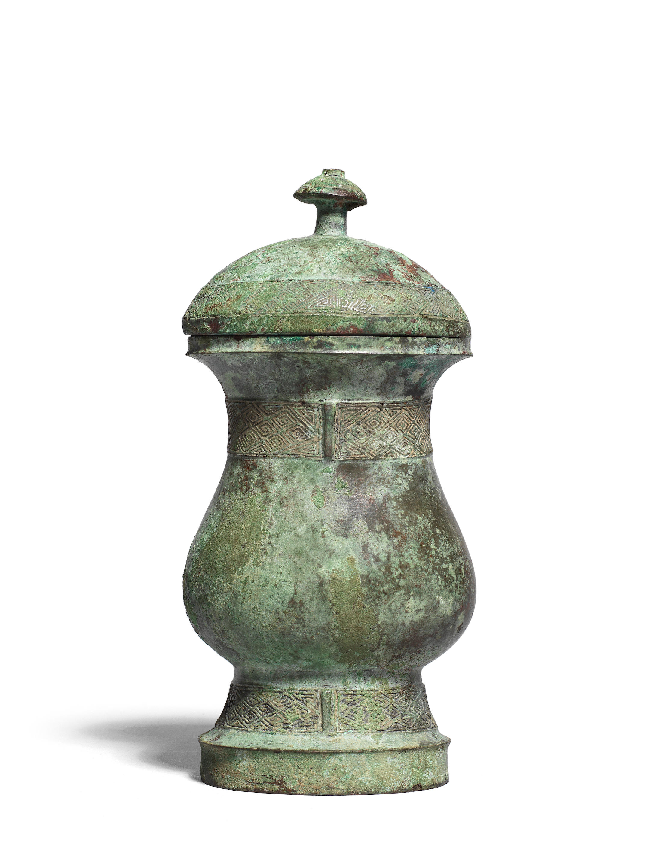 An archaic bronze wine vessel and cover, zhi