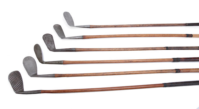 A collection of six fancy faced irons