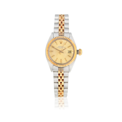 Rolex. A lady's stainless steel and gold automatic calendar bracelet watch Date, Ref: 6916, Sold 9th May 1986
