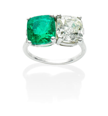 An emerald and diamond two-stone ring